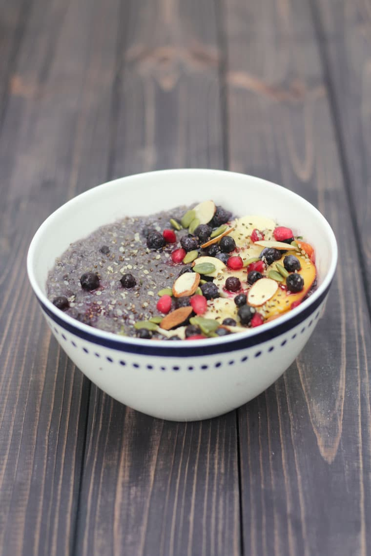 This healthy gluten free slow cooker vegan breakfast quinoa is backed with blueberries, bananas and absolutely no added sugar!