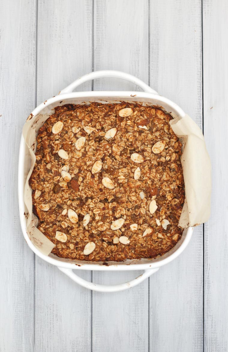 An overhead image of granola bars in a white baking dish.