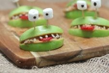 Close up of halloween apple alien smiles.