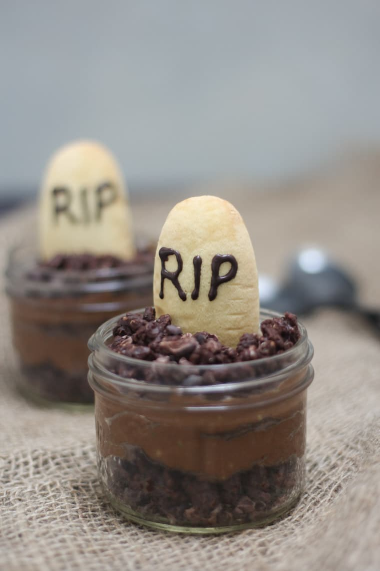 Halloween themed chocolate mousse in small clear jars.