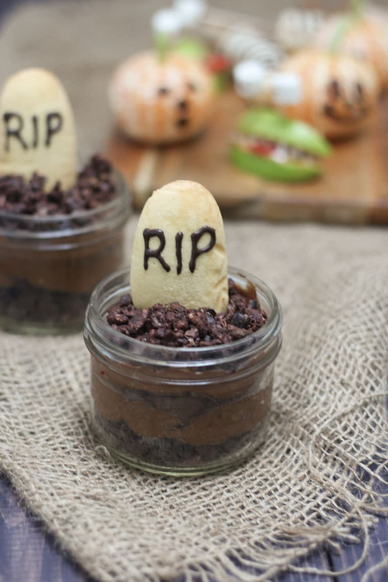 This Vegan Halloween Chocolate Mousse Graveyard with Gluten Free Crispy Chocolate Soil is the perfect Halloween treat to serve at your Halloween party- for adults and kids, alike!