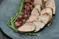 A high protein gluten free Paleo Rosemary Pork Tenderloin with Pear Cranberry Rosemary Sauce that's easy enough for a weeknight but elegant enough for hosting company!