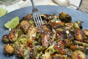 I'm spicing things up for Thanksgiving by serving up my tasty vegan and gluten free sweet chili roasted brussels sprouts side dish.
