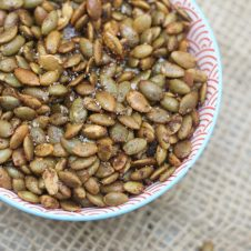 TheseSweet and Spicy Roasted Pumpkin Seeds are a perfect Gluten Free & Vegan Snack for entertaining or healthy snacking!