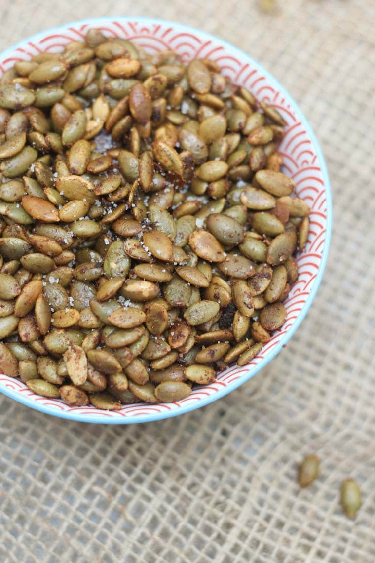 These Sweet and Spicy Roasted Pumpkin Seeds are a perfect Gluten Free & Vegan Snack for entertaining or healthy snacking!