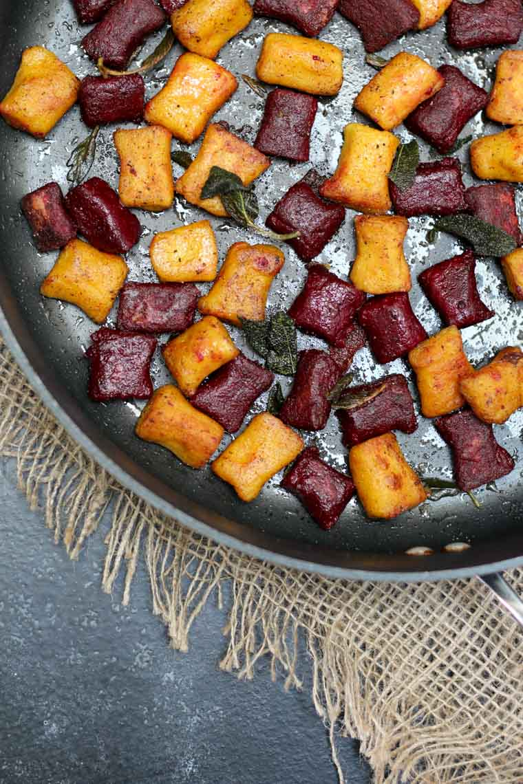 Colourful beet pasta in a pan.