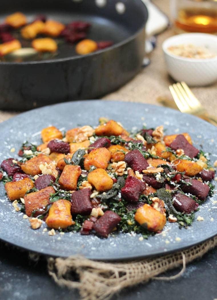 Beet gnocchi served on a platter.