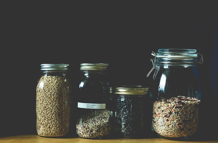 glass jars containing whole grains