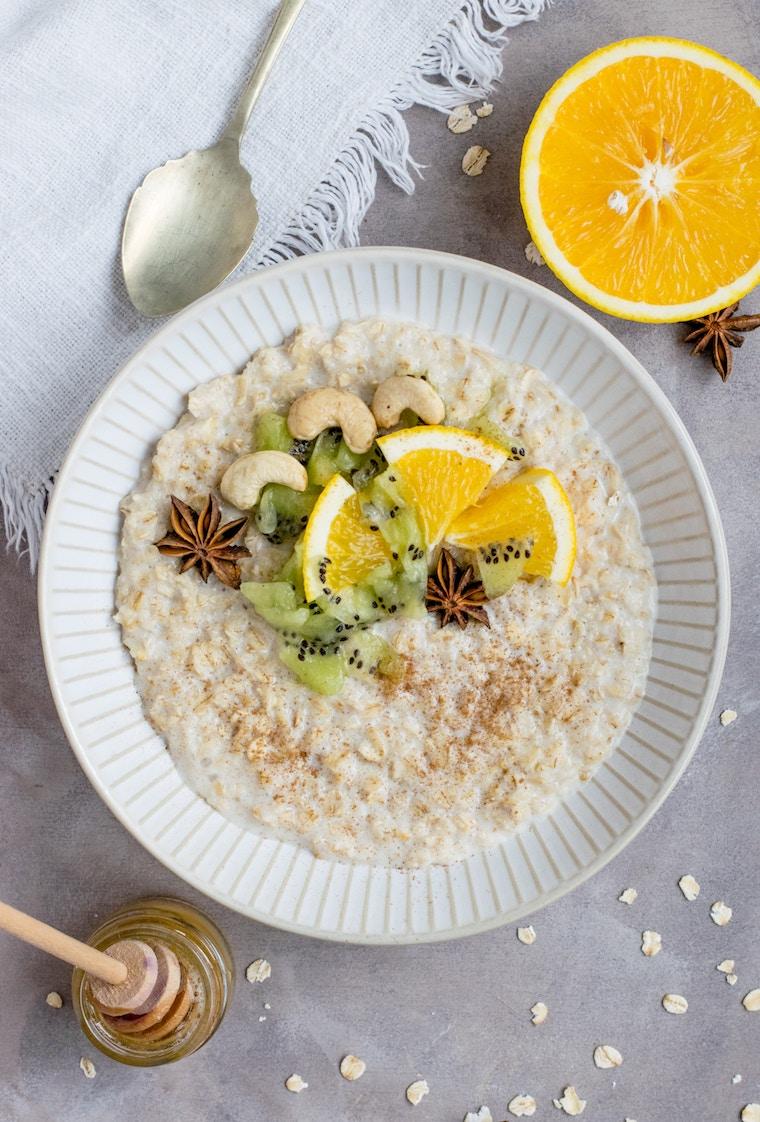 """Overheat image of porridge with fruit on top.\"""""""