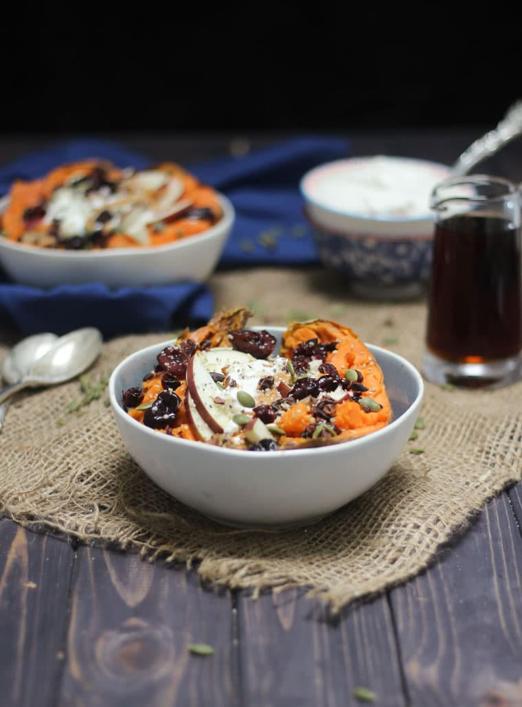 Stuffed sweet potato with toppings in a bowl.