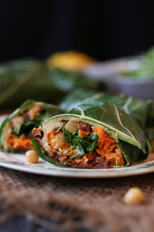 close up image of mediterranean collard green wrap on a white plate