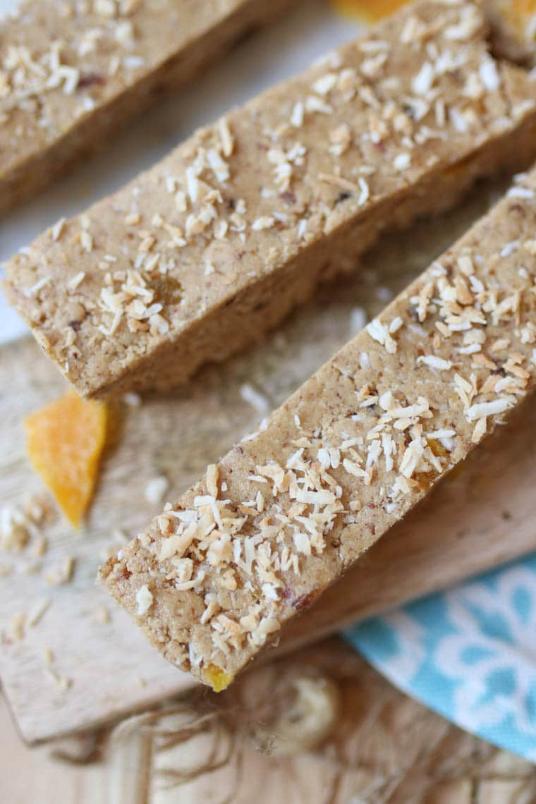Close up of protein bars topped with dried mango and shredded coconut.
