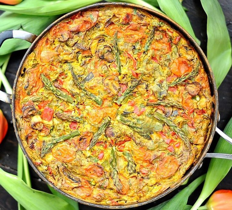 birds eye view of vegan and gluten free frittata for easter brunch served in a black skillet