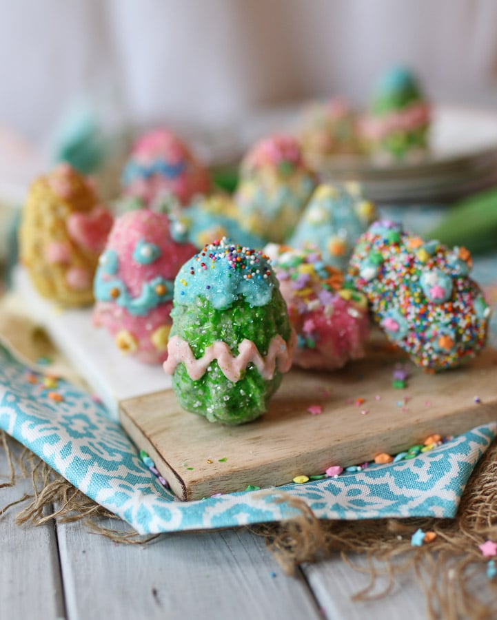 rice krispie easter eggs on a wooden plate
