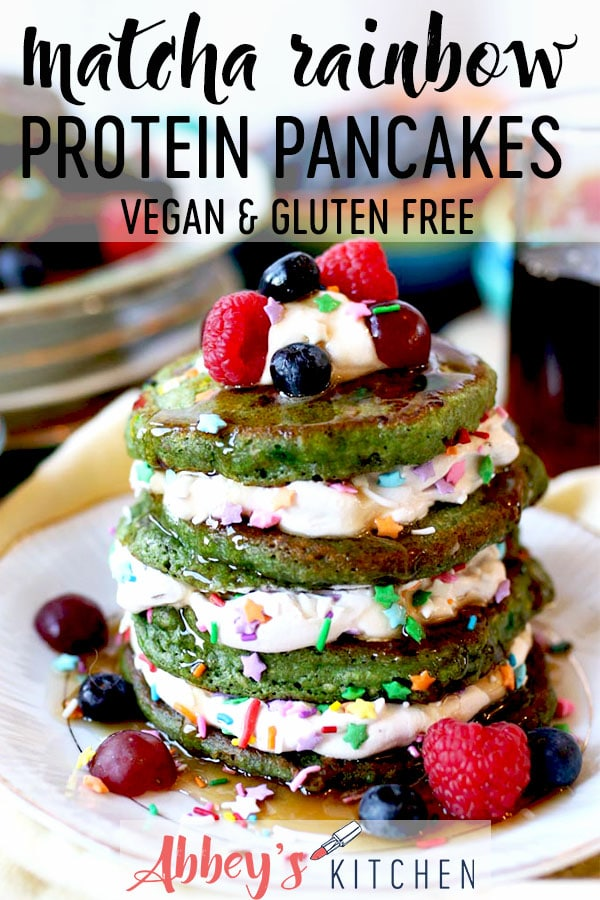 pinterest image of Stack of matcha rainbow protein pancakes on a white plate with text overlay