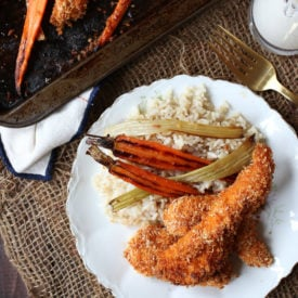 ThisGluten Free Buffalo Chicken Fingers Sheet Pan Dinner with Roasted Carrots and Celery is a simple one pan wonder that also make great freezer meals for crazy nights.