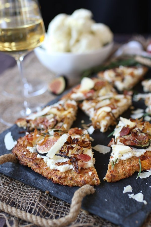 Apple, fig and onion cauliflower pizza flatbread cut into slices.