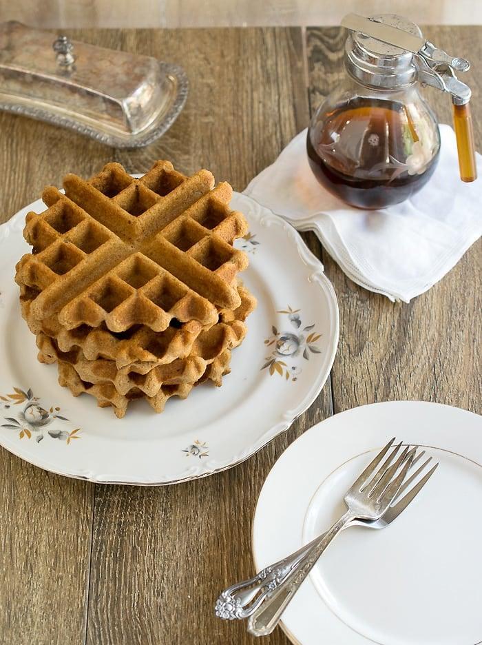 Chai spiced waffle on a white plate.