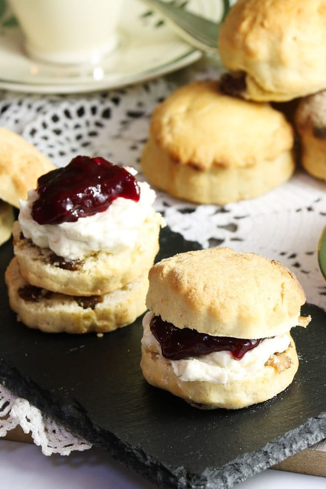 Vegan scones on a dark serving dish.