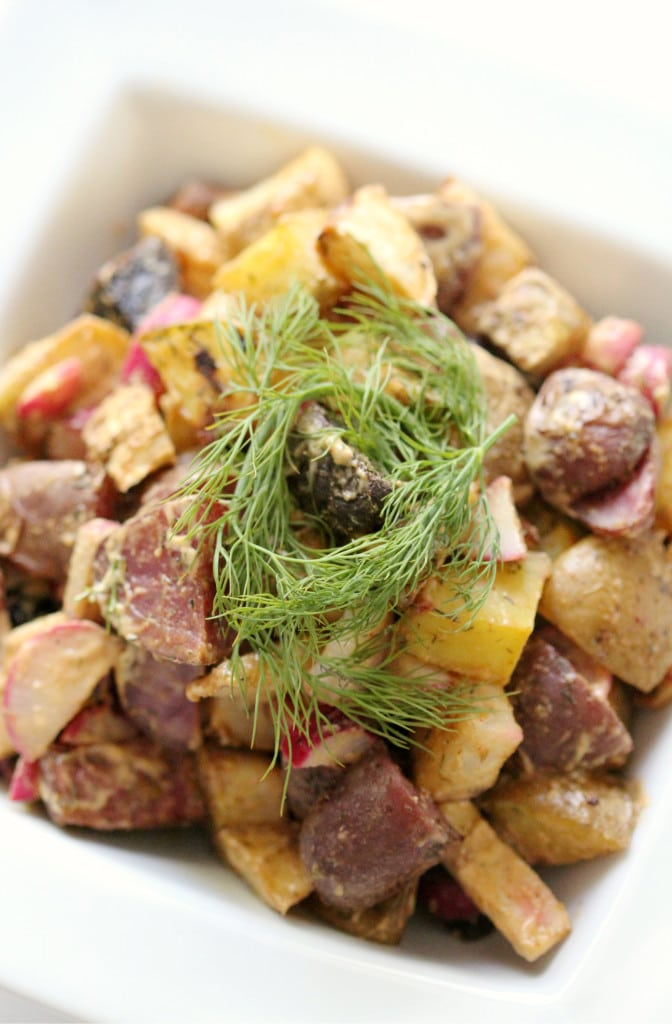 Potato salad topped with dill.