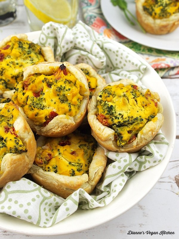 Broccoli quiche cups in a white serving dish.