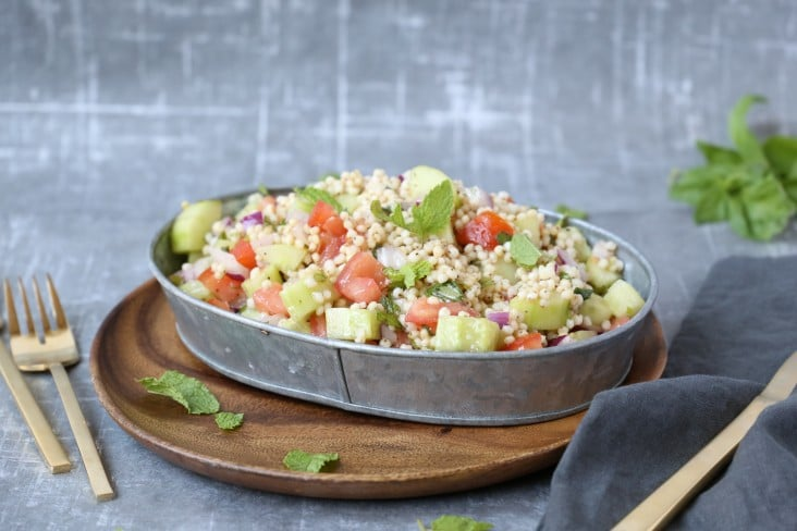Israeli style sorghum salad with tomato and cucumber.