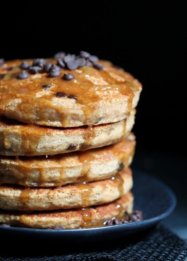 Peanut butter chocolate chip pancakes on a grey plate.