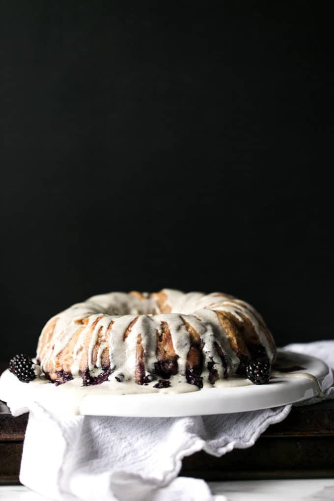 Blueberry bread pudding breakfast cake on a white serving dish.
