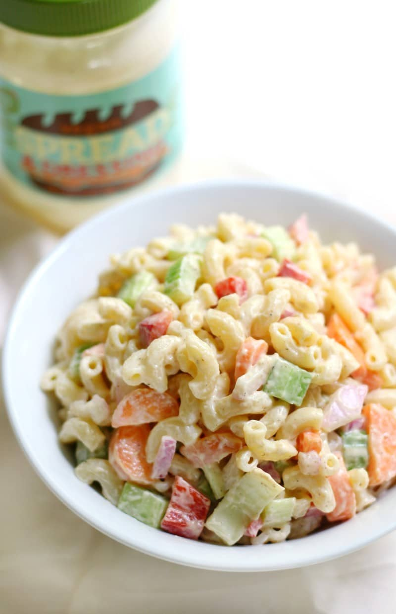 Macaroni salad in a white bowl.