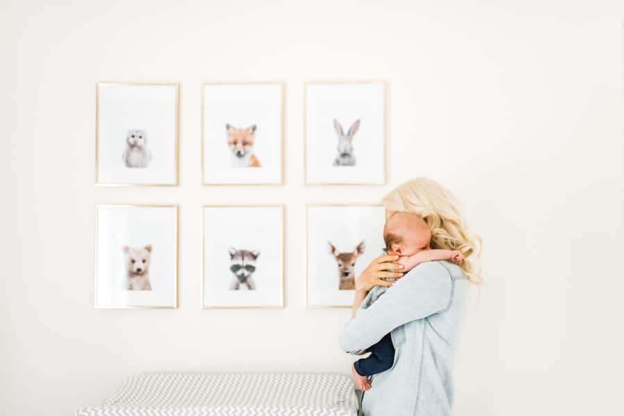 image of abbey holding baby E in a toddler's bedroom