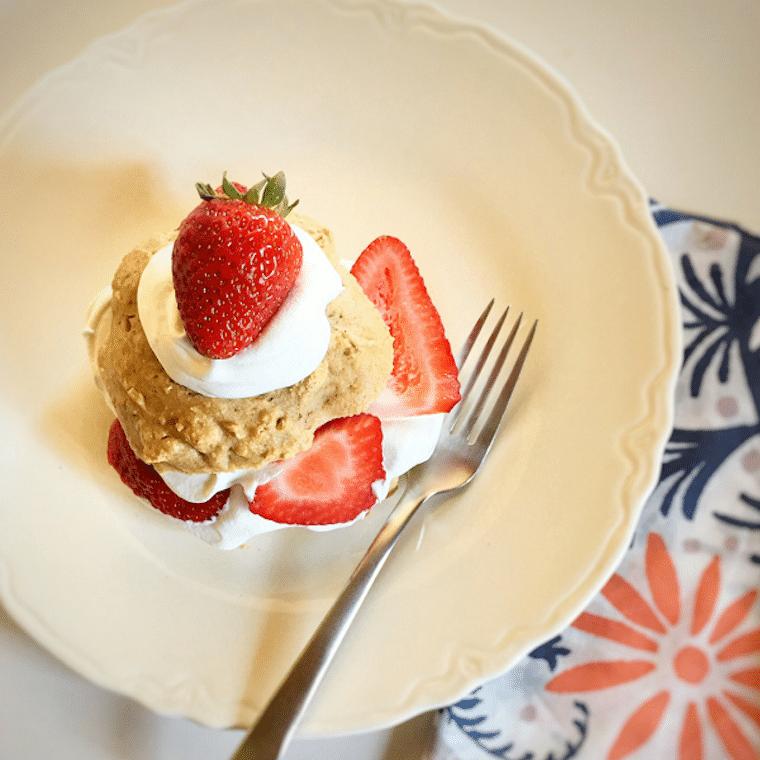 Strawberry shortcake on a white plate.