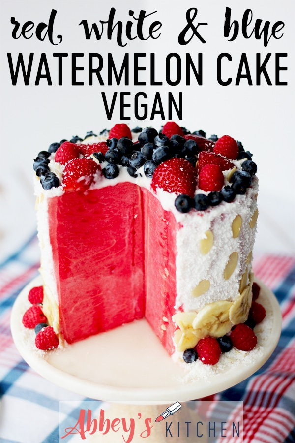 pinterest image of watermelon cake garnished with berries on a white plate with text overlay