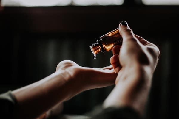 hand holding castor oil