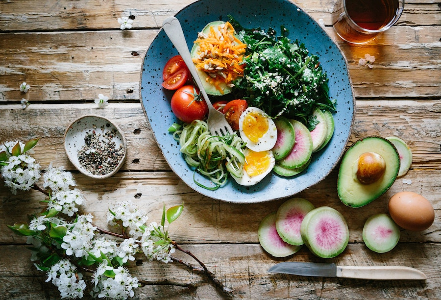 A salad on a wooden board.