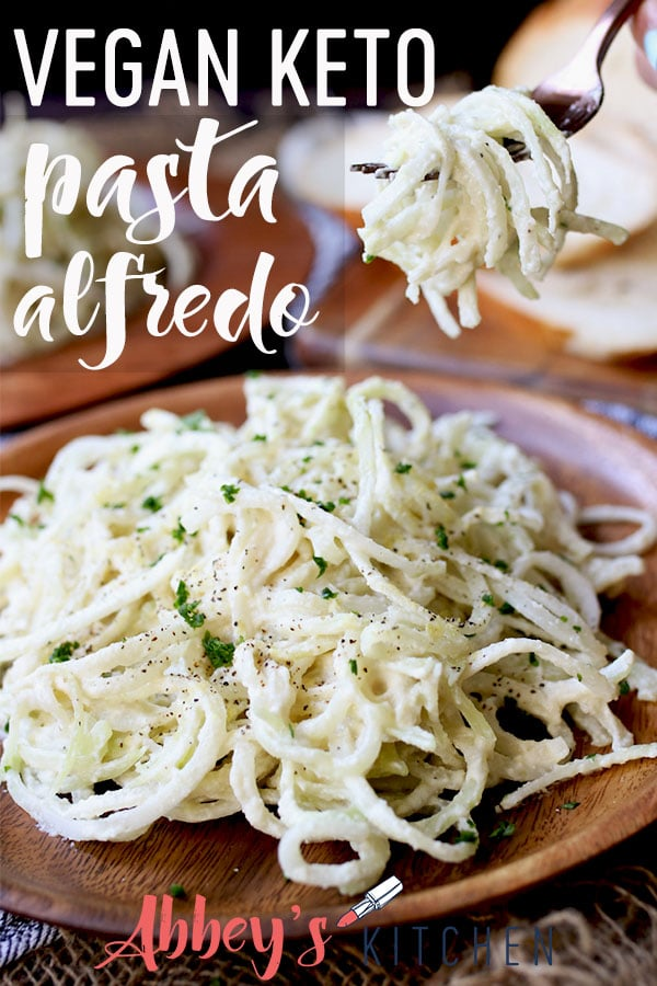 pinterest image of vegan keto pasta alfredo topped with herbs on a wooden plate