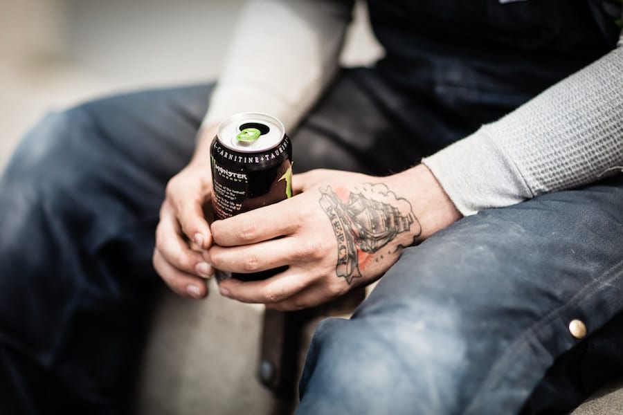 Person holding a can.