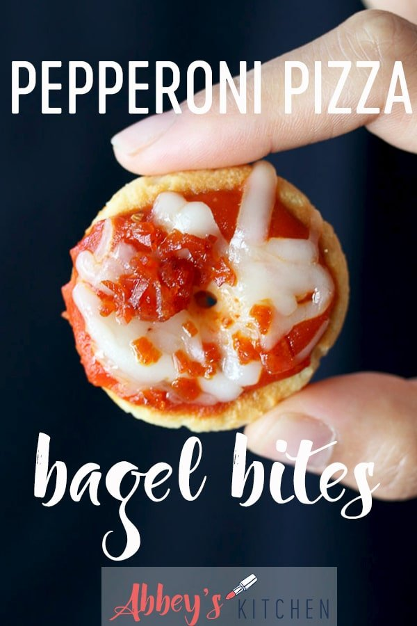 pinterest image of Hand holding homemade bagel bites with text overlay
