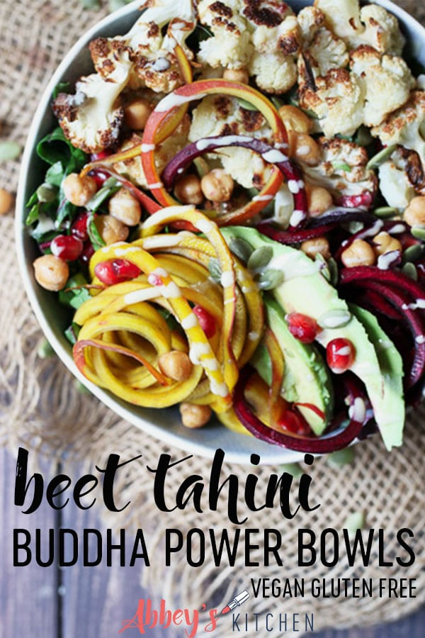 pinterest image of vegan tahini beet buddha bowl garnished with pomegranate seeds with text overlay