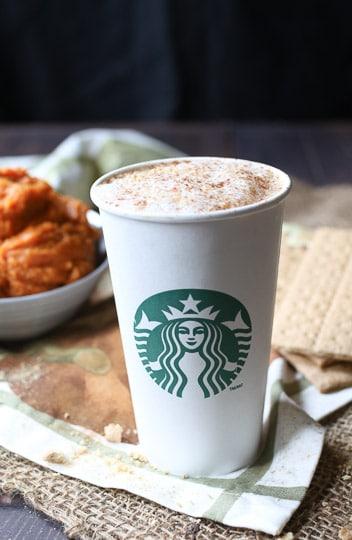 Pumpkin latte in a starbucks cup.