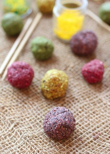 Colourful cake pop balls on a burlap blanket