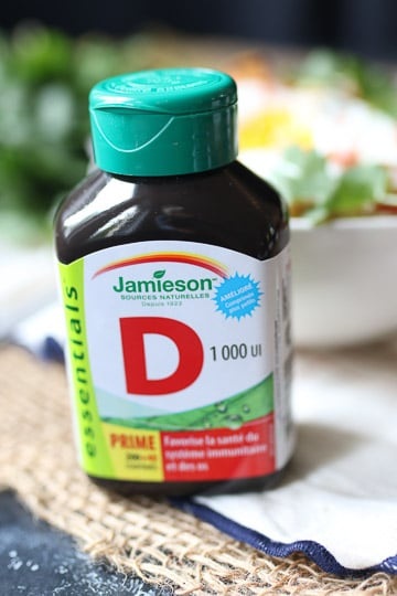 close up of a bottle of vitamin D supplements