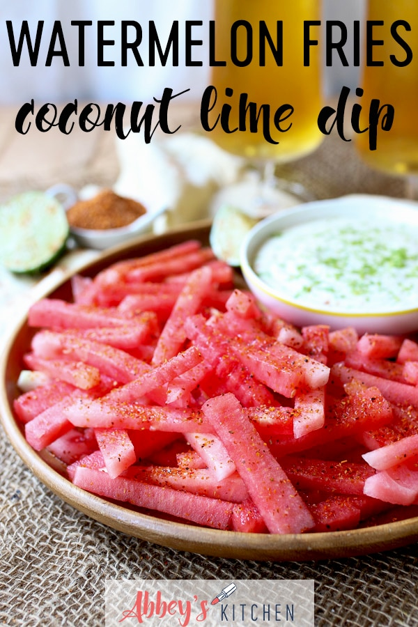 watermelon fries served on a wooden plate next to dip.