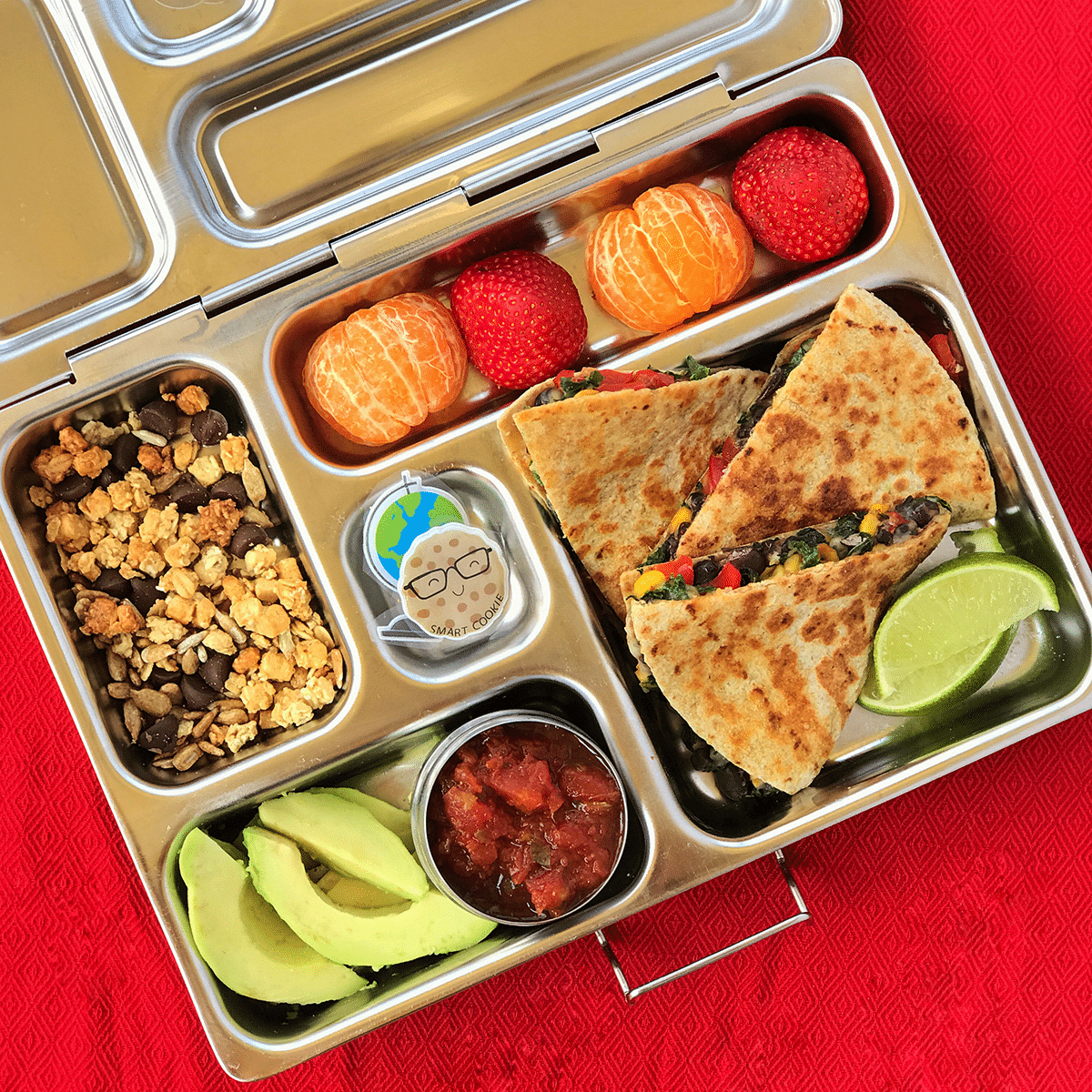 Quesadillas served in a lunch box.