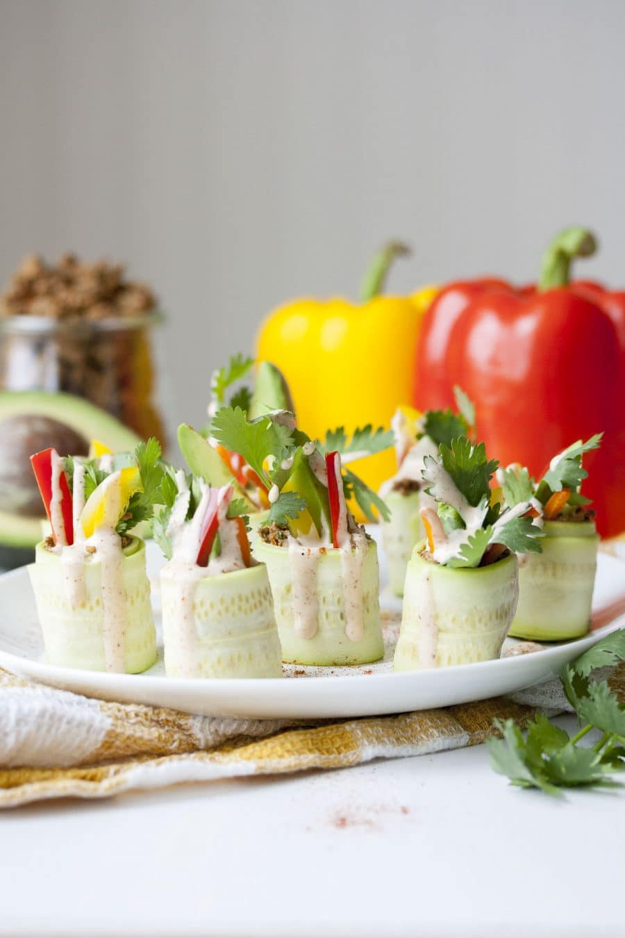 Zucchini roll ups on a plate.