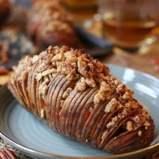 Try my Vegan Gluten Free Hasselback Sweet Potatoes with Streusal Topping as a holiday side dish. #abbeyskitchen #sweetpotatoes #hasselbackpotatoes #streusal #holidaysidedish #holidays #holidaydinner #vegansidedish #glutenfreefood #potatoes #healthysidedish