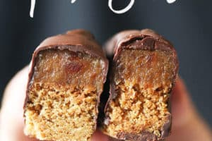 A hand holding up two vegan Twix bars.