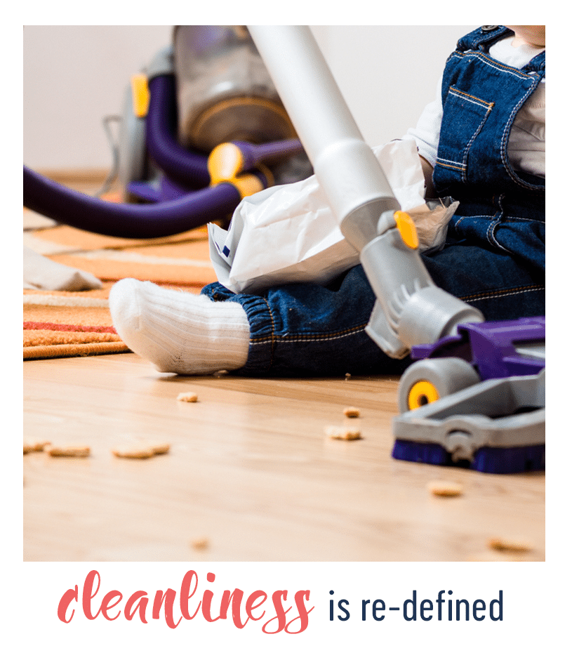 infant next to a mess and a vacuum cleaner with text below