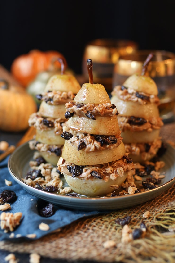 These Vegan Granola Layered Poached Pears are a delicious dairy free, gluten free, healthy, and easy holiday dessert for entertaining friends with diet restrictions!