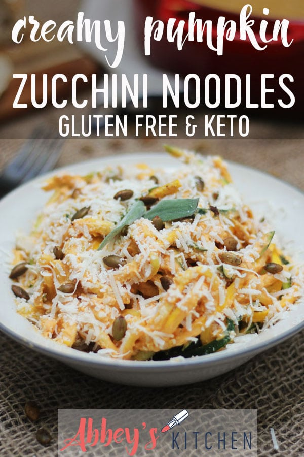 pinterest image of creamy gluten free and keto pumpkin zoodles topped with spiced pumpkin seeds in a white bowl with text overlay