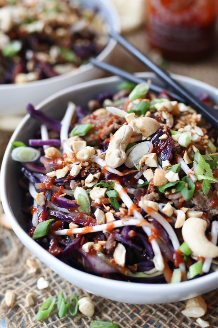 low carb egg roll in a bowl dinner recipe in a grey bowl garnished with nuts and seeds